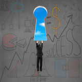 Climbing to key shape door with business doodles Royalty Free Stock Photos