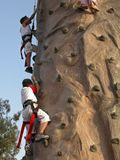 Climbing to reach the top. Friends are climbing to reach the top on a playground Stock Photo