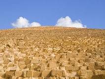 Climbing to the sky. Wall of the Cheops pyramid in Giza Royalty Free Stock Photos