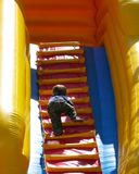 Climbing to the top. Child climbing steps on slide attraction. Concepts climbing to the top and advancement Stock Photo