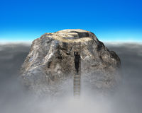 Climbing to top of euro symbol shape rocky mountain Royalty Free Stock Photo