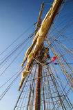 Climbing to the Top in  Mast old Sailing Ship. Climbing to the Top in a Mast of an old Sailing Ship under a blue sky Royalty Free Stock Images
