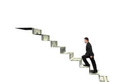 Climbing to top of money stairs. Isolated in white background Royalty Free Stock Photo