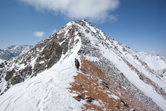 Climbing to the top of the mountain Stock Photography