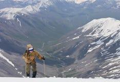 Climbing to the top of the snow Stock Photos