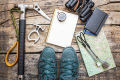 Climbing tools with boots on wood background Royalty Free Stock Image
