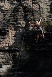 Climbing on rocks towers in Prachov rocks royalty free stock photos