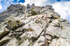 Climbing trail with chains in the mountains Stock Photo