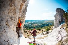 Training rock climbers in nature. Royalty Free Stock Image