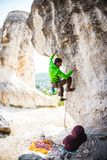 Training rock climbers in nature. Royalty Free Stock Images