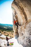 Training rock climbers in nature. Royalty Free Stock Photo