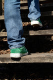 Climbing Up. Legs in blue jeans Stock Photography