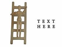 Climbing up. Wooden Manikin climbs up wooden-ladder Royalty Free Stock Photos