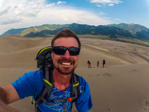 Climbing up the Great Sand Dunes Colorado royalty free stock photo