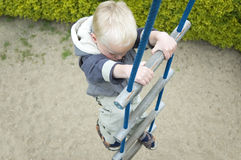 Climbing Up The Stairs. Kid climbing up stairs on a playground, taken from above royalty free stock images