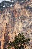 Climbing on a vertical rock. Via ferrata climbing wall in Austrian Alps stock photos