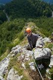 Climbing on via ferrata. People climbing on a via ferrata route in the mountains Royalty Free Stock Image