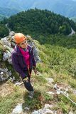 Climbing on via ferrata. Woman climbing on a via ferrata route in the mountains Stock Images
