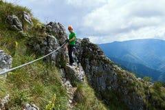 Climbing on via ferrata Royalty Free Stock Photos