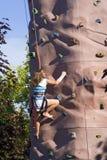 Climbing Wall. A girl climbs a portable rock climing wall stock photos