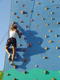Climbing wall. Young woman training on the climbing wall Stock Photos