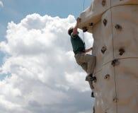 Climbing Wall. Climbing a 5.10 route on a rock climbing wall royalty free stock photo