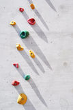 Climbing wall. Colorful plastic pieces on an artificial climbing wall Royalty Free Stock Images