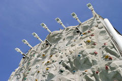 Climbing Wall From Below. A view of the top of a climbing wall from below stock photo