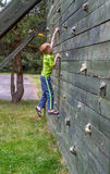 Climbing on a wall Royalty Free Stock Photography