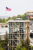 Climbing Wall in Glass Tower with American Flag Stock Image