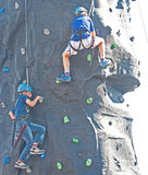 Climbing wall at ' Go wild on the Canal ' event. Two young children using the climbing wall provided as part of the entertainment at the ' Go wild on the Canal Royalty Free Stock Photos