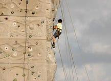 Climbing Wall IV. Kid climbing on awall Stock Photo