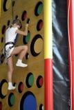 Climbing wall. Little girl climbs up the climbing wall Royalty Free Stock Photos