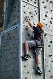 Climbing wall. LONDON, UK - SEPTEMBER 7TH, 2014: a person climbing up a wall at a street fair in Woolwich Arsenal, London, UK Royalty Free Stock Photos