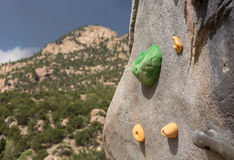 Climbing wall with mountains in background Royalty Free Stock Photos