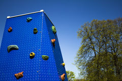 Climbing wall at playground in park. Climbing wall at children's playground in park Stock Image