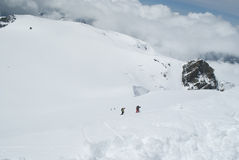 Climbing western breithorn. Alpinists climbing western breithorn on monte rosa Stock Image