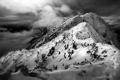 Climbing in the winter. Winter climbing, snow, blizzard, menacing skies Stock Photo