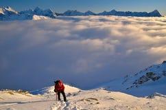 Climbing in winter mountains.