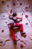 Climbing woman Royalty Free Stock Image