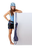 Climbing woman holding a banner Royalty Free Stock Photography