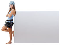 Climbing woman holding a banner Stock Photos