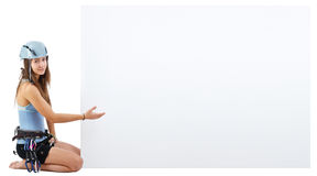 Climbing woman holding a banner Stock Photo