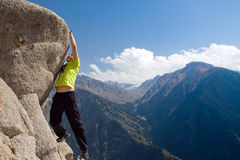Climbing young adult at the top of summit Royalty Free Stock Photography