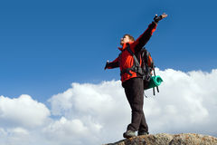 Climbing young adult at the top of summit Stock Images