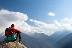 Climbing young adult at the top of summit Royalty Free Stock Images