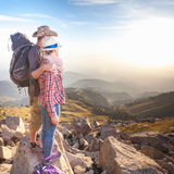 Climbing young couple at top of summit with aerial view Stock Photo