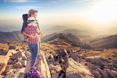 Climbing young couple at top of summit with aerial view Stock Photography