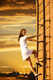 Climbs. Girl on fire climbs stairs Royalty Free Stock Images