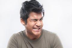 Clin d'oeil asiatique d'expression d'homme photo libre de droits